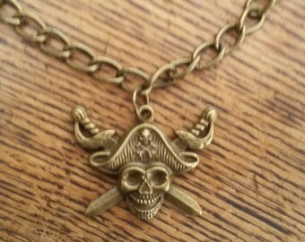 Antique brass tone pirate / skull and crossbones chain necklace