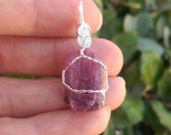 Terminated pink tourmaline wire wrapped pendant 21 carats