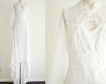 Vintage white lace bohemian wedding dress . 1970s jersey victorian style long train empire waist wedding gown . small