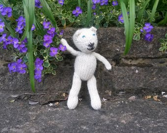 Polar Bear - a hand knitted soft toy teddy in natural cream coloured 100% wool