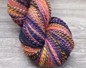 "Handspun Yarn – 2-ply, Worsted-Aran weight, Falkland wool, purple, pink, orange, colorway ""Ethel"""