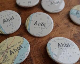 Button Ahoy holiday handprinted on map coast sailing ship