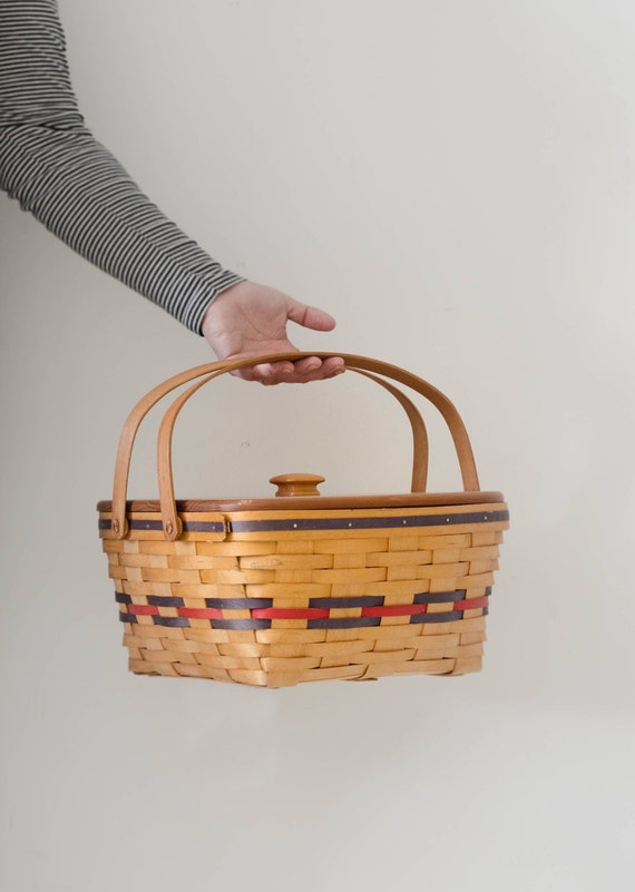 Vintage picnic basket with wooden lid
