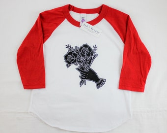 Red Baseball Tee, traditional tattoo design of hands holding flowers