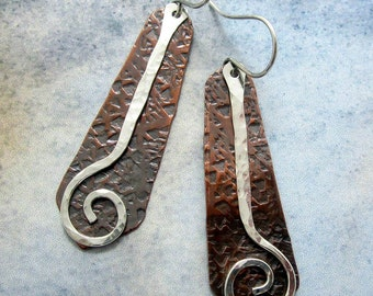 Long textured copper earrings with silver spirals