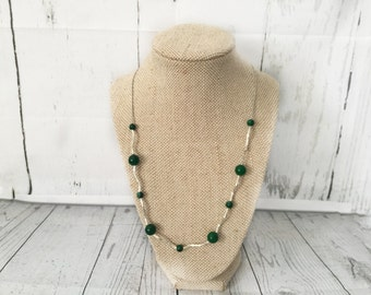 Necklace, silver chain with lush green gemstone beads.