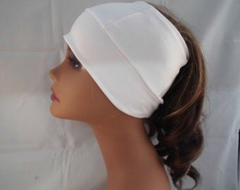 Spandex , beanie with hole in top for ponytail, natural hair or braids.