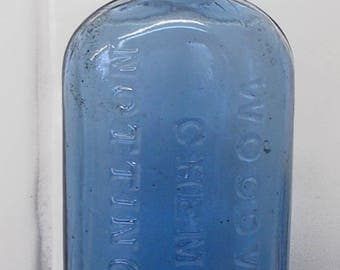 Blue glass Woodward Chemist Nottingham apothecary medicine bottle, Victorian. Vintage antique collectible druggist drugstore medical nursing