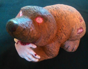 Zombie eats Mole hand, ceramic figure repaint, polymer clay