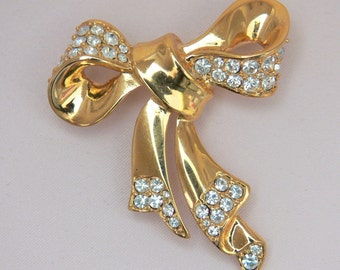 Signed MONET Christmas pin - Golden bow ornamented with clear rhinestones galore. Very nice.  CCB-3