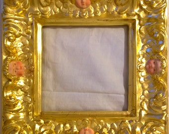 Golden frame with papier-mâché mirror