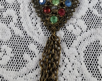 Up cycled Vintage Earring made into a Tassel Pendant Beaded Necklace.