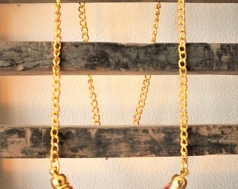 Purple knitting wool and brass necklace