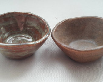 Two handmade pinch pot ceramic salt and pepper bowls Brown and Green