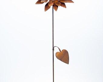 Whimsical weathered sunflower garden sculpture