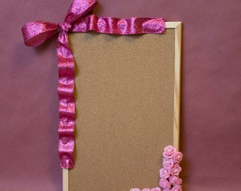 Decorated corkboard. Elegantly pink with pearls