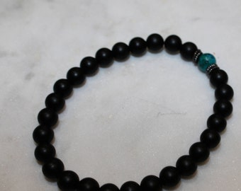 Beaded black onyx bracelet with turquoise accent bead