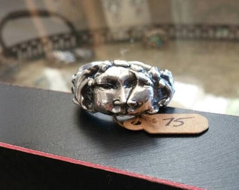 Artisan fine silver man in the moons face ring