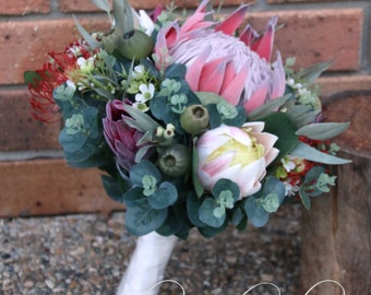 Rustic bridal bouquet, bridesmaid bouquet.  King protea, pink ice protea, Geraldton wax, pin cushions, gumnuts, Australian native foliage.