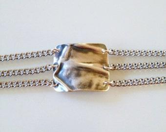 Fold formed silver filled metalwork chain bracelet