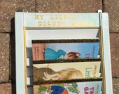 Repurposed vintage SHUTTER, holds Little Golden Book size storybooks, mounts to wall, custom child's name added, painted in gold letters