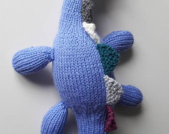 Hand knitted blue dinosaur