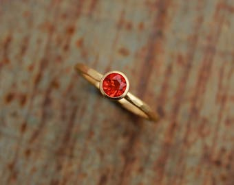 18k gold ring with fire opal