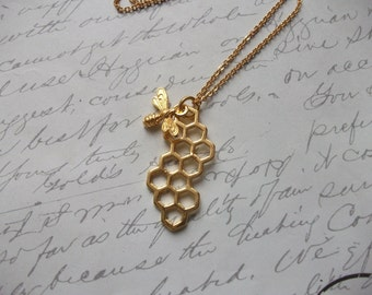 Honeycomb with bee gold necklace