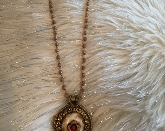 Crochet Tibetan Necklace- Chain is made with faceted Czech glass beads with Tibetan brass shell pendant