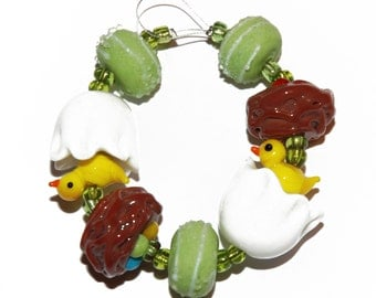 Glass Lampwork Bead Assortment Strand for Jewelry Making: Yellow Chick in Egg, Bird Nest with Eggs, Green Frosted Rondelle w/Stripe Design