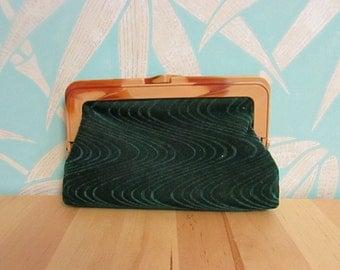 Vintage dark green velveteen clutch bag with marbled tan plastic frame & contrast maroon lining