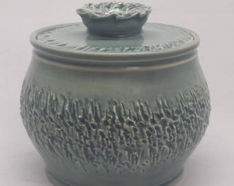 Wheelthrown stoneware lidded pot.