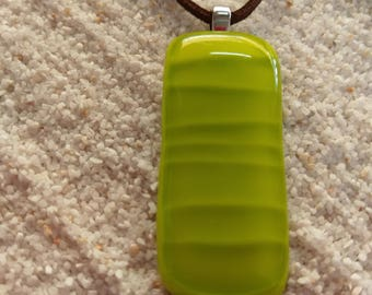 Large lime green glass pendant with interesting layered look