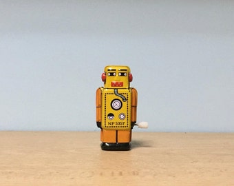 Vintage yellow wind-up tin toy robot,miniature toy for collectors,collectible robot, wind up toy, retro collection