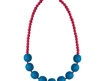 Red and teal resin necklace designed by Frank Ideas