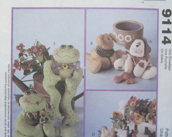 McCall's 9114. Bean Bag Pal Designs -- Pattern pieces and instructions to make bean bag animals, all with bow or scarf trims. Uncut.