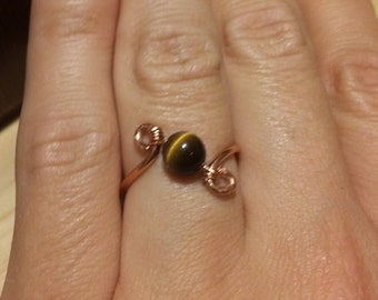 Copper wire wrapped tiger's eye bead ring us size 7.5