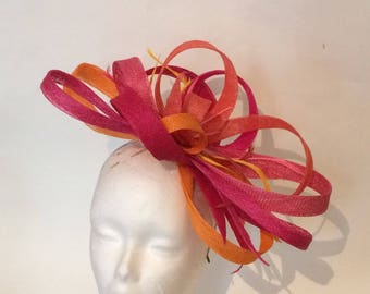 Hat pink and orange swirls