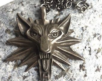 Witcher pendant necklace in antiqued bronze metal