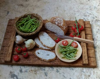 Rustic platter with green beans and tomatoes.