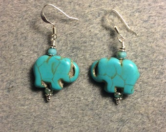 Turquoise howlite gemstone elephant bead earrings adorned with turquoise Chinese crystal beads.