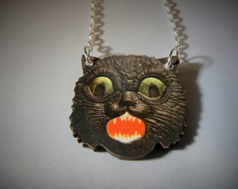 small louis wain esque scaredy cat statememnt necklace