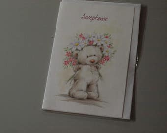 Acceptance Card with a Teddy with Flowers on her Head