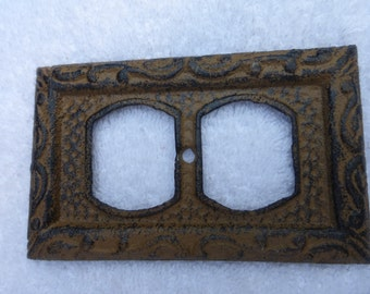 Rustic Cast Iron Outlet Cover olde fashioned rustic brown black highlights