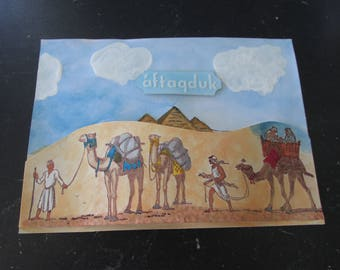 Eygtians heading home from long trip, Pyramids in the background, 3D card with words in white ('aftaqduk - miss you)