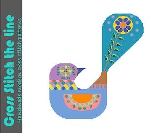 Colourful modern cross stitch pattern of a bird. Contemporary pattern inspired by folk art. Boho cross stitch pattern.