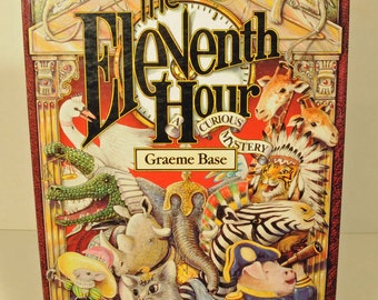 The Eleventh Hour, A Curious Mystery, Graeme Base, children's book, birthday party, mystery and detective story, stories in rhyme, animals