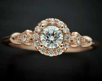 Diamond Engagement ring  Pink, white, yellow gold or Platinum with a round center GIA and round halo