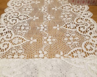 Stunning vintage lace trim wide lace double edged trim slight elasticity 6.5 inches wide x 1.3 metres length . White lace. Made in France