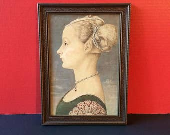 Framed print of Portrait of a Young Woman by Antonio del Pollaiuolo circa 1465-70